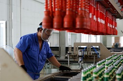 Vietnam beverage industry worker at the production line
