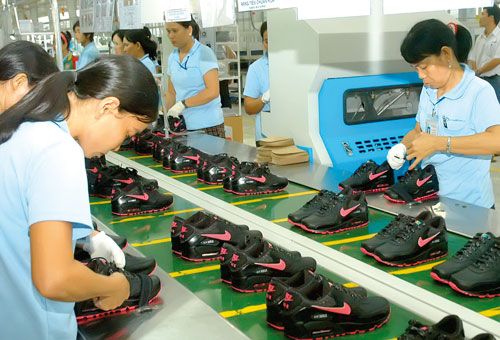 Vietnam footwear worker at the production line